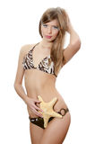 The young beautiful girl with a starfish isolated Stock Image