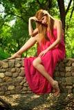 Young beautiful girl on a stone bridge Royalty Free Stock Photos