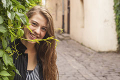 Young beautiful girl on a street in the old town. Happy. Stock Photo