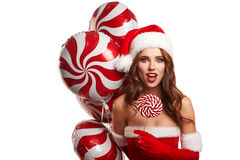 Young beautiful girl in the studio for the new year, christmas . Royalty Free Stock Photography