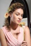 Young beautiful girl studio portrait. Young beautiful girl is holding a flower. Studio portrait Stock Image