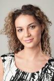 Young beautiful girl studio portrait. Young beautiful girl is smilimg Royalty Free Stock Photo
