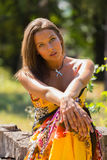 The young beautiful girl of summer park. A beautiful dresses and jewelry. Professional makeup. Outdoor recreation. Sport fishing. Photos for magazines, posters Stock Photo