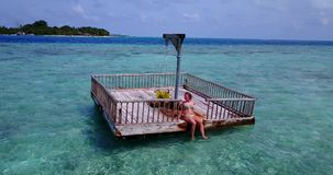 V08125 young beautiful girl sunbathing on pontoon with drone aerial flying view in clear blue sea and sunshine Stock Images
