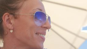 beaca39ebc Young beautiful girl in sunglasses beach reflection. concept of holiday at  sea. stock footage