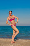 Young beautiful girl in swimsuit at the beach. In the summer Stock Photo