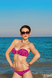 Young beautiful girl in swimsuit at the beach. In the summer Stock Image