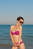 Young beautiful girl in swimsuit at the beach. In the summer Stock Photos