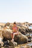 Young beautiful  girl in swimsuit bikini posing on beach, fashion model, fitness figure. Stock Photo