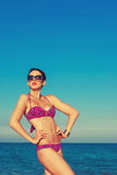 Young beautiful girl in swimsuit and sunglasses. Young beautiful girl with in swimsuit and sunglasses at the beach Royalty Free Stock Photo