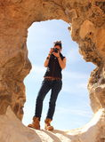 Young beautiful girl takes a picture in the middle of the amazing White desert close to Farafra oasis in Egypt Royalty Free Stock Photo
