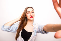 Young beautiful girl taking Selfie picture Royalty Free Stock Photography