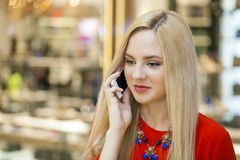 Young beautiful girl talking on cell phone Stock Images