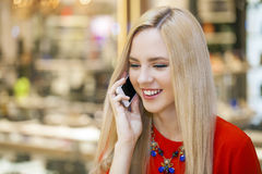 Young beautiful girl talking on cell phone Stock Photos