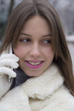 Young beautiful girl talking on a mobile phone Royalty Free Stock Photo