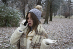 Young beautiful girl talking on a mobile phone Royalty Free Stock Images