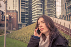 Young beautiful girl talking on phone in the city streets Stock Image