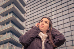Young beautiful girl talking on phone in the city streets Stock Images