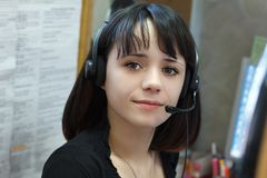 Young beautiful girl telephone operator Stock Photos