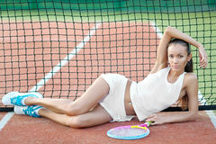 Young, beautiful girl on the tennis court Stock Images