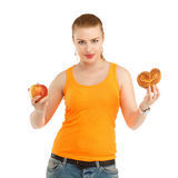 Young beautiful girl in thinking what to eat to lose weight - th Stock Photos