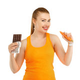 Young beautiful girl in thinking what to eat to lose weight - th royalty free stock photography