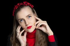 Young beautiful girl touches her long fingers to her face royalty free stock photo