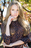 Young beautiful girl touching her face, outdoor autumn portrait Stock Photography