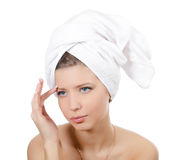 The young beautiful girl with a towel on hair Stock Photo