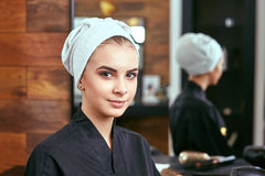 Young, beautiful girl with a towel on his head after shampooing Stock Photography