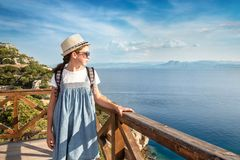 Young beautiful girl traveling along the coast of the Mediterranean Sea royalty free stock photo