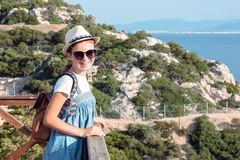 Young beautiful girl traveling along the coast of the Mediterranean Sea stock photos