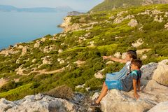 Young beautiful girl traveling along the coast of the Mediterranean Sea royalty free stock photos