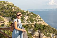 Young beautiful girl traveling along the coast of the Mediterranean Sea stock photography