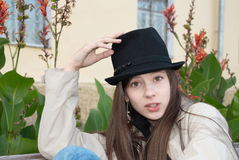 Young beautiful girl in a trilby hat Stock Images