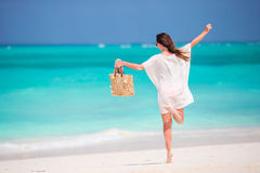 Young beautiful girl on the tropical beach Royalty Free Stock Image