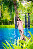 Young beautiful girl in a tropical island. Summer vacation conce Stock Image