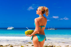 Young beautiful girl in the turquoise bikini is standing on the Royalty Free Stock Photos