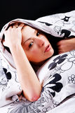 Young beautiful girl under blanket Royalty Free Stock Image
