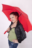 Young beautiful girl under the red umbrella Stock Photo