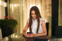 Young beautiful girl use a laptop during a break at work. Summer sunny day. Stock Images
