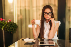 Young beautiful girl use a laptop during a break at work. Summer sunny day. Stock Photo