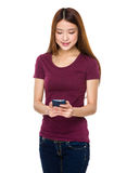 Young beautiful girl using mobile phone Royalty Free Stock Photo