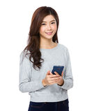 Young beautiful girl using mobile phone Royalty Free Stock Images