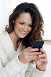 Young beautiful girl using smart phone Stock Image