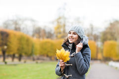Young and beautiful girl walking in an autumn park Royalty Free Stock Images