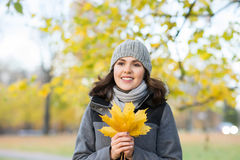 Young and beautiful girl walking in an autumn park Royalty Free Stock Photo