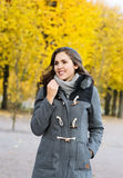 Young and beautiful girl walking in an autumn park Royalty Free Stock Photography
