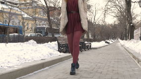 Young beautiful girl walking through the city streets. stock video