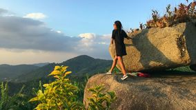 Young Beautiful Girl Walking to Amazing Viewpoint To See Sunset. Slow motion travel motivation video. Thailand. stock video footage